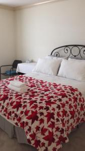 A bed or beds in a room at Go House