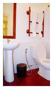 Ein Badezimmer in der Unterkunft Oasis Hotel