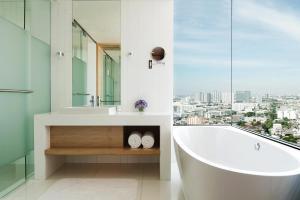 A bathroom at Avani Plus Riverside Bangkok Hotel -SHA Certified