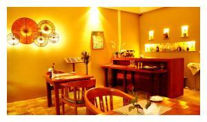 Ein Restaurant oder anderes Speiselokal in der Unterkunft Oasis Hotel