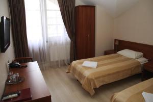 Кровать или кровати в номере Визави