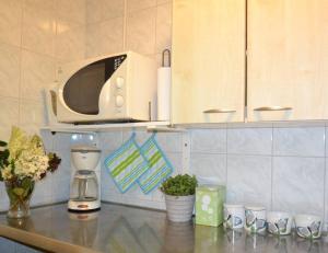 Majoituspaikan Laitalan Lomat keittiö tai keittotila
