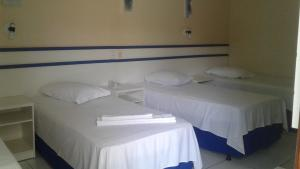 A bed or beds in a room at Hotel Lago Azul