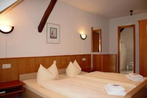 Кровать или кровати в номере Pension Ujut