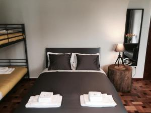 Een bed of bedden in een kamer bij AC House