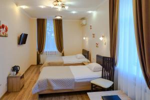 Кровать или кровати в номере Отель Арагон