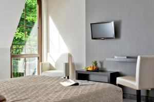 Łóżko lub łóżka w pokoju w obiekcie Rezydencja Eger