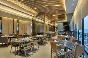 A restaurant or other place to eat at Swiss-Belinn Simatupang