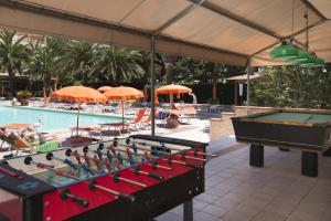 A pool table at Hotel Oasis