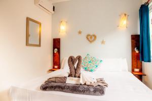 Кровать или кровати в номере Mango Tulum Hotel