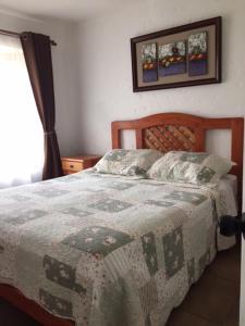 Cama o camas de una habitación en Cabañas Aires del Bosque