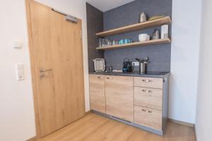 Küche/Küchenzeile in der Unterkunft Pension Breitenauer See