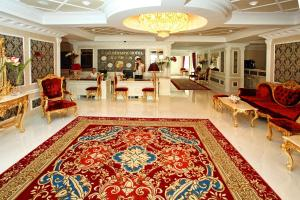 The lobby or reception area at Royal Olympic Hotel