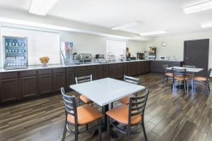A restaurant or other place to eat at Super 8 by Wyndham Montgomery I-65