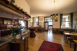 The lounge or bar area at Hotel Rheinland Bonn - Bad Godesberg