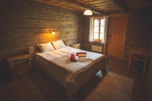 Vuode tai vuoteita majoituspaikassa Holiday Village Suur Töll