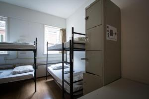 A bunk bed or bunk beds in a room at Stone Hotel & Hostel