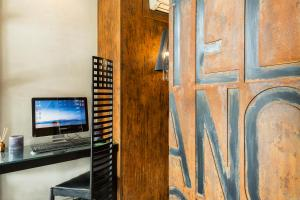 A television and/or entertainment center at Hotel Ancora