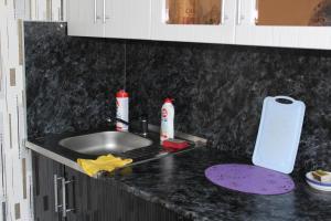 Кухня или мини-кухня в Апартаменты на Советской 21