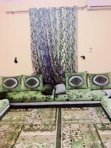 A seating area at Zahra Apartments