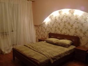 Кровать или кровати в номере Апартаменты 2 х комнатные