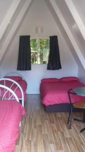 A bed or beds in a room at Westport Kiwi Holiday Park & Motels