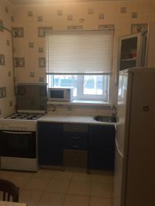 Кухня или мини-кухня в Гостевой Дом в Кузяево