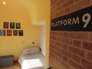 A bed or beds in a room at Al Nove e TreQuarti