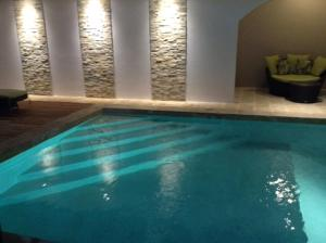 The swimming pool at or near Hotel Flor De Sarta