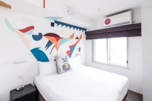 Cama o camas de una habitación en Majestic Minima Hotel