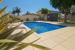 The swimming pool at or near The Sands Holiday Apartments
