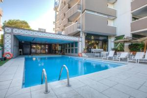 The swimming pool at or near Hotel Imperiale Rimini