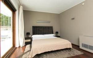 Un ou plusieurs lits dans un hébergement de l'établissement Hotel Zhero