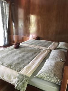A bed or beds in a room at Dusita Koh Kood Resort