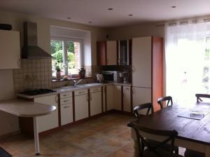 A kitchen or kitchenette at La Doucine