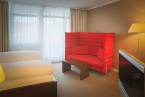 A seating area at Altera Hotel