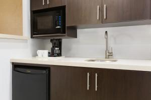 A kitchen or kitchenette at Travelodge by Wyndham Toronto East