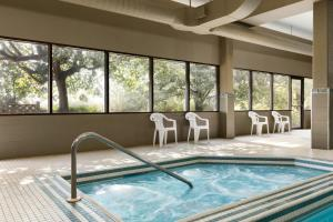 The swimming pool at or near Travelodge by Wyndham Toronto East
