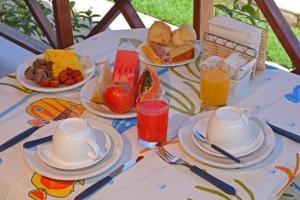 Opções de café da manhã disponíveis para hóspedes em Pousada Solar da Praia