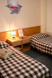 A bed or beds in a room at Hotel Veli Jože
