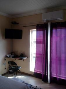 A television and/or entertainment center at Fahms B&B Gaborone North