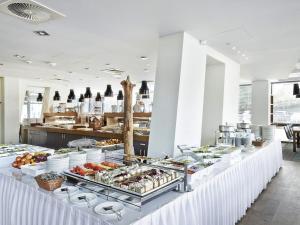 Restauracja lub miejsce do jedzenia w obiekcie VacationClub - Olympic Park Apartment B606