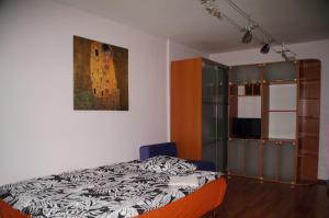 Кровать или кровати в номере Апартаменты м.Павелецкая