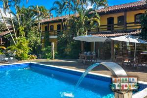 A piscina localizada em Pousada Praia do Jabaquara ou nos arredores