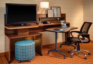 A television and/or entertainment center at Fairfield Inn & Suites by Marriott St. Paul Northeast