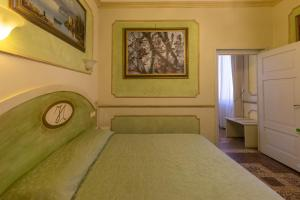 A bed or beds in a room at Antica Residenza D'Azeglio Room&Breakfast di Charme