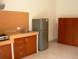 A kitchen or kitchenette at Fruits Villa