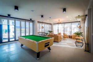 A pool table at Triple Z Hotel