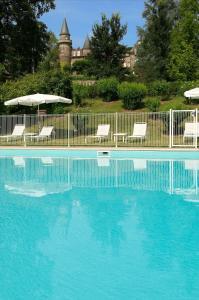 The swimming pool at or near Hôtel Château de Castel Novel - Les Collectionneurs