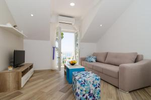 A seating area at Apartments Marmo